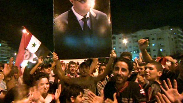 Bashar al-Assad supporters in Latakia