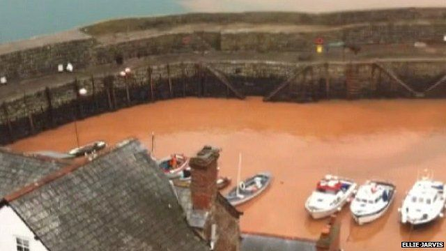 Flood water gushed into the harbour