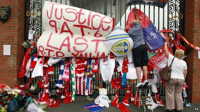 """Shankly Gates next to the Hillsborough Memorial at Liverpool""""s Anfield Stadium"""