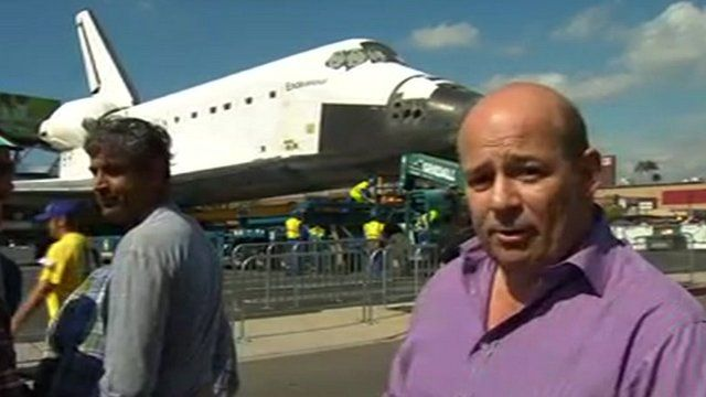 Alistair Leithead in front of the retired space shuttle Endeavour