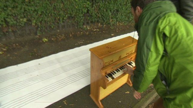 Man playing piano using marks from bird droppings