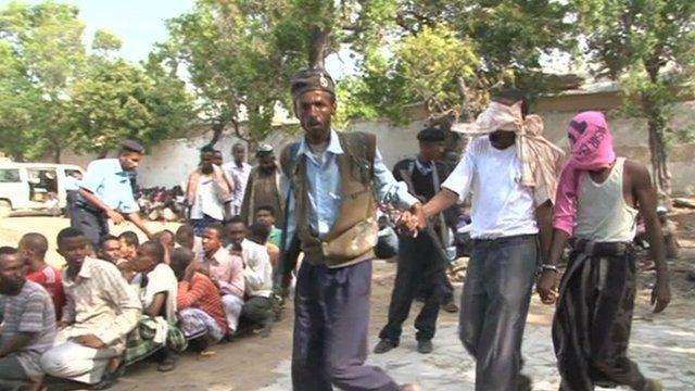 Militant suspects being taken away