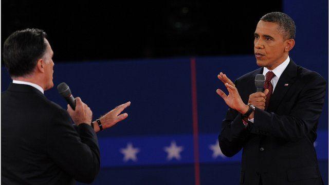 Mitt Romney and Barack Obama on stage in New York