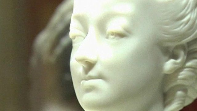 Statue at auction house