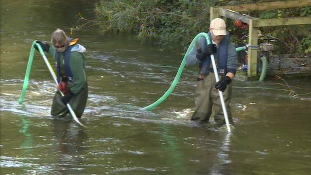 Volunteers clearing the river beds of silt