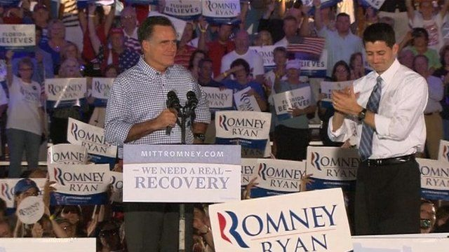 Mitt Romney (l) on stage with Paul Ryan in Florida