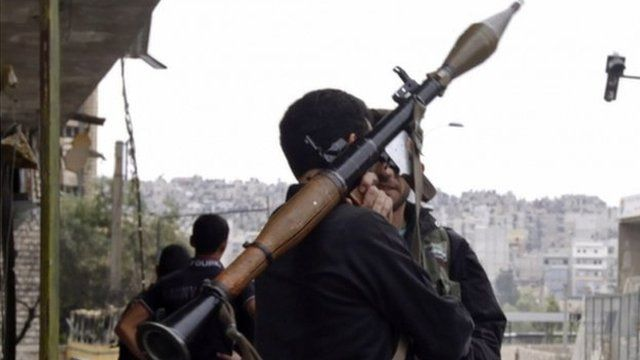 Rebel with weapon in Aleppo
