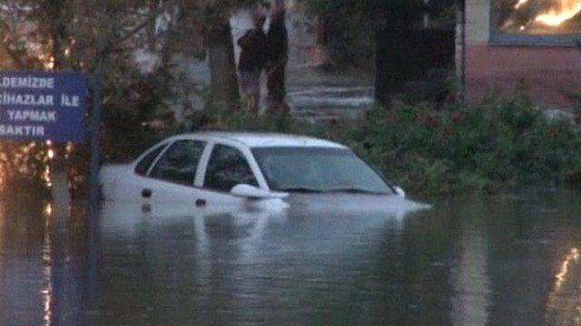 A car in an flooded street in Turkey