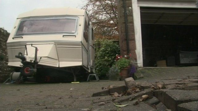 Caravan and flood damaged paving
