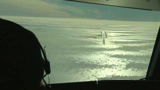 Pilot looks over runway in Antarctica