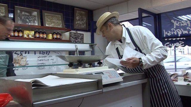 Fishmonger in shop in Leyton
