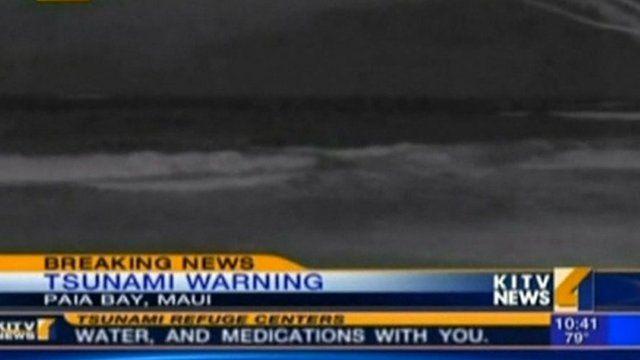 Tsunami waves reach land