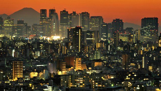 Mount Fuji behind the skyline of the Shinjuku area of Tokyo at sunset