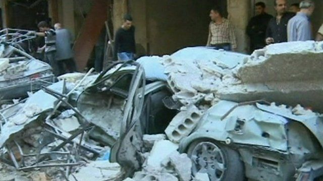 A car crushed by the rubble from a building