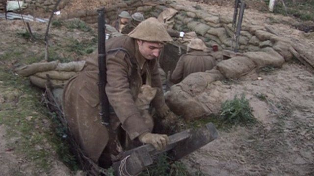 "Surrey ""soldier"" getting out of a trench"