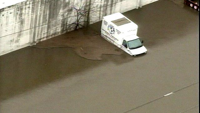 Aerial view of partially submerged van