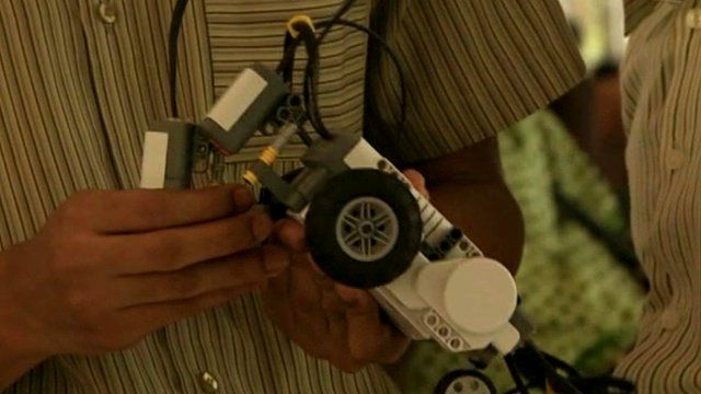 A Ghanaian student with lego robot