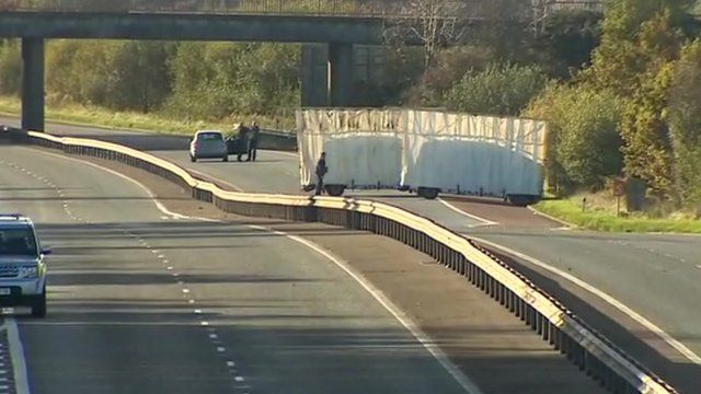 The scene of the shooting is screened off on the M12 between Portadown and Lurgan