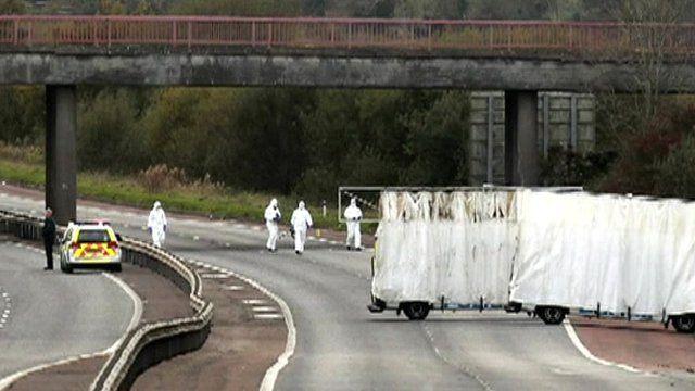 Crime scene investigators on the motorway