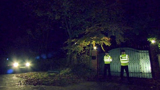 Police officers outside Freddie Starr's house in Warwickshire