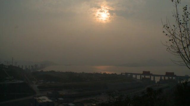 Sun breaks through cloud over Three Gorges Dam, China