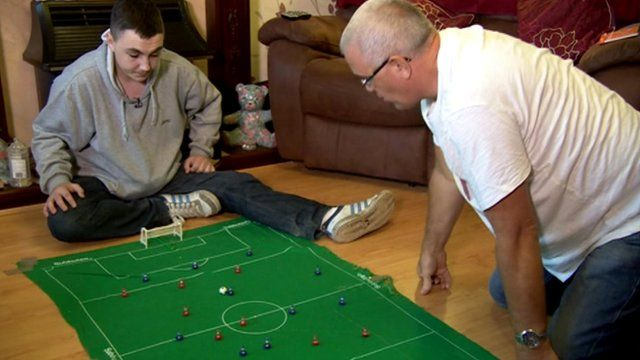 Fostered teenager playing Subutteo football