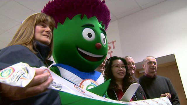 Volunteers and Clyde the mascot of the Commonwealth Games 2014