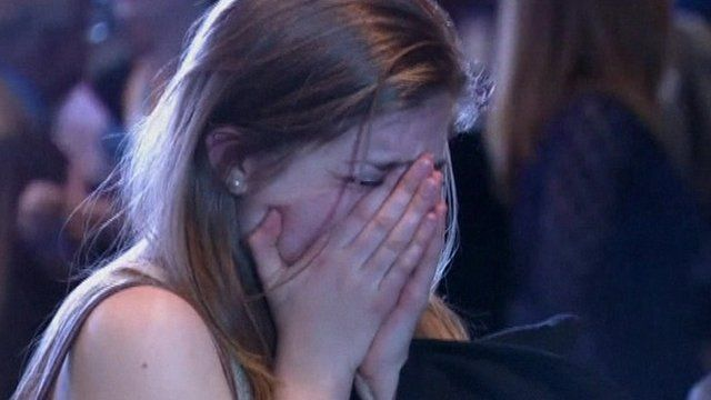 Romney supporter crying into her hands