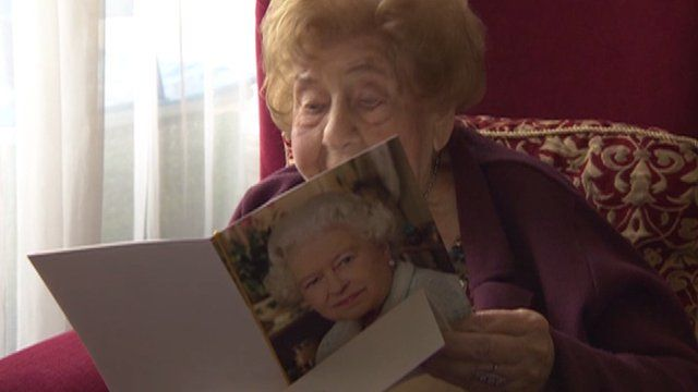 Johanna Waller reads her birthday card from the Queen