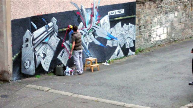 Graffiti artist Ian Tayac at work