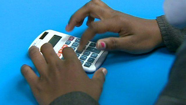Child using calculator