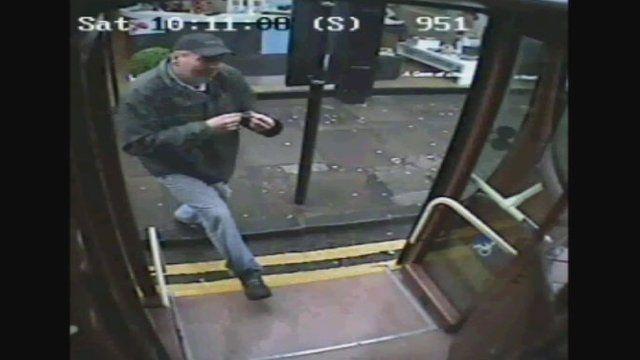 CCTV of man boarding a bus