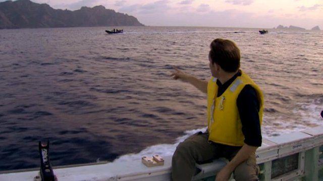 Rupert Wingfield-Hayes on boat in front of Senkaku/Diaoyu Islands