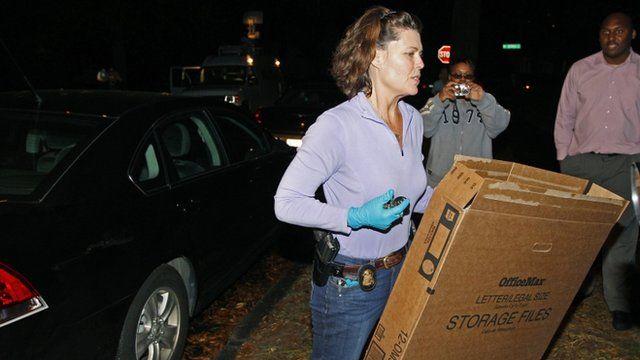 FBI agent carrying cardboard box
