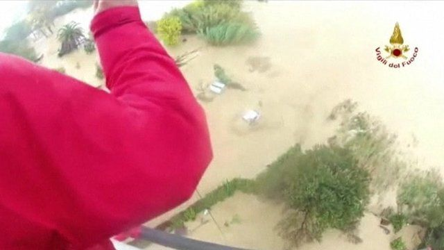 Rescuer looking out of helicopter