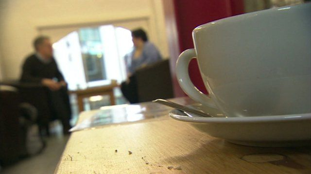 Cup of tea and blurred people