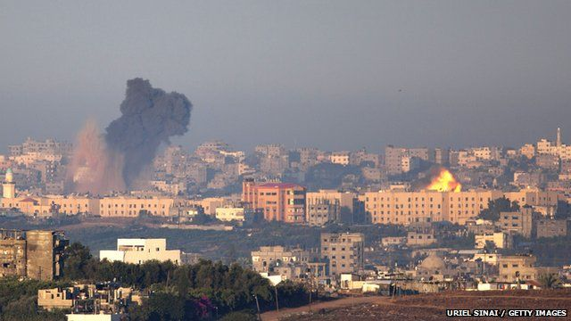 A plume of smoke rises over Gaza during an Israeli air strike, as seen from Sderot on November 15, 2012 in Israel.