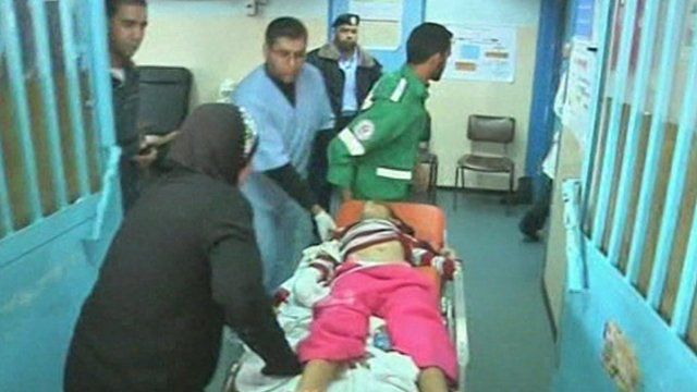 Injured girl on a stretcher in Gaza
