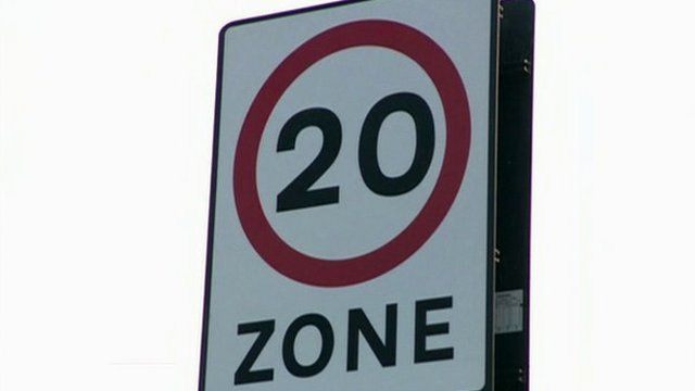 20 miles per house road sign