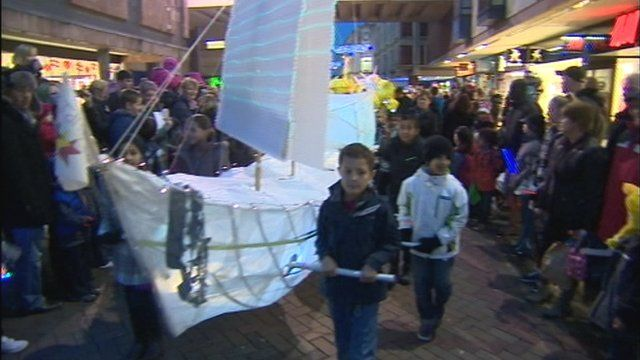 A Christmas lights parade in Gloucester city centre