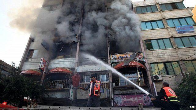 Gaza firefighters at scene of air strike. 19 Nov 2012
