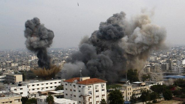 Smoke raises as another missile approaches the target during an Israeli air strike in Gaza City