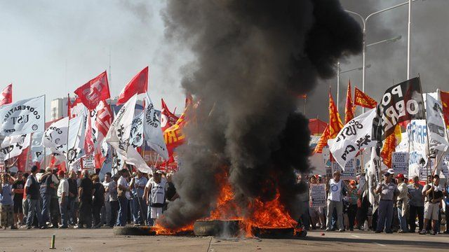 Demonstrators block the Pueyrredon Bridge during a one-day nationwide strike in Buenos Aires
