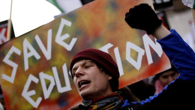 A protestor demonstrating against education cuts