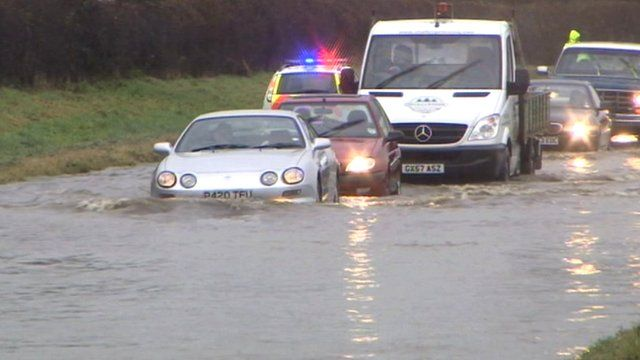 Cars on a flooded road