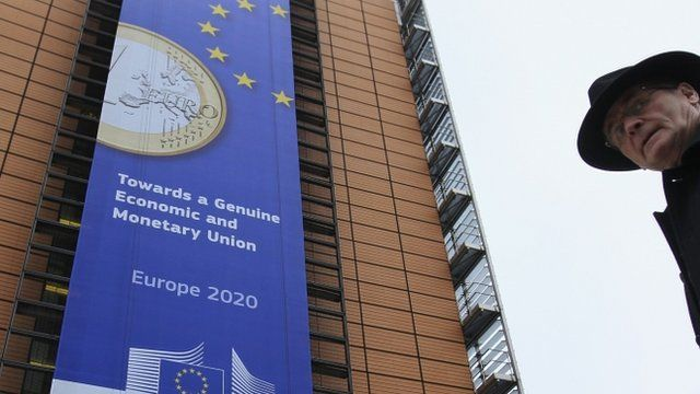 Banner featuring euro coin on EC headquarters building