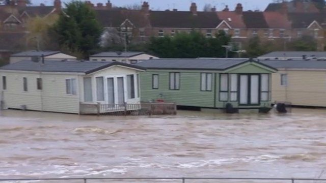 Caravans on flotation devices near the River Avon in north Evesham