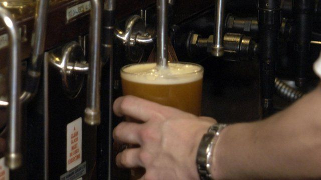 Pint being poured in pub
