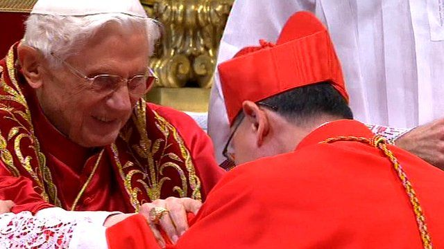 Pope Benedict XVI and one of the appointed cardinals