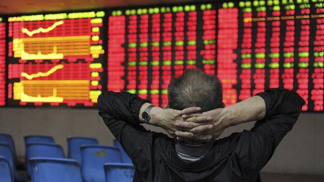 An investor in front of an electronic stock indicator board in Hefei, Anhui province